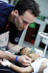 A ERU doctor treats a child in Sri Lanka